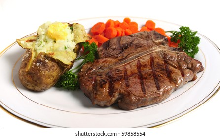 A dinner of a Porterhouse (or T-bone) steak, with baked potato filled with mashed parsley potato topped with butter, served with sliced carrots and garnished with parsley