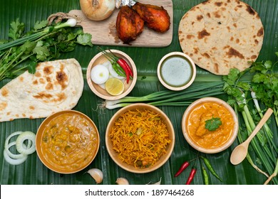 Dinner preparation of various indian food menus, biryani rice, butter chicken, tandoori, bean curry and naan bread