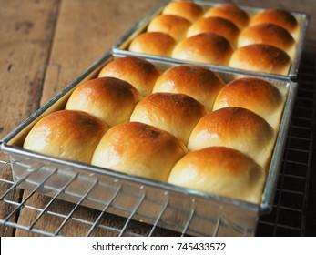 dinner roll bread on wood