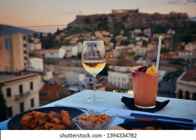 Dinner at rooftop with the view of Acropolis in Athens, Greece.