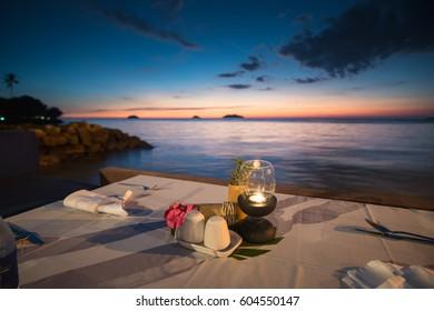 dinner setting on the beach sunset in Thailand.