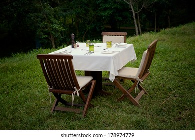 A dinner setting for three outdoors in Uganda.