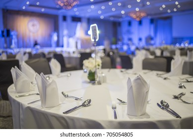 Dinner table in the banquet room of a luxury hotel.