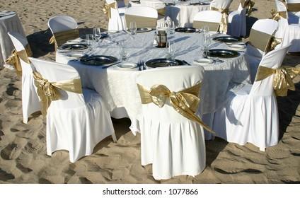 Dinner table at a beach wedding