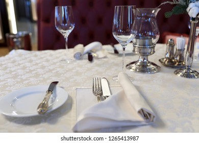 Dinner table with cutlery in the restaurant
