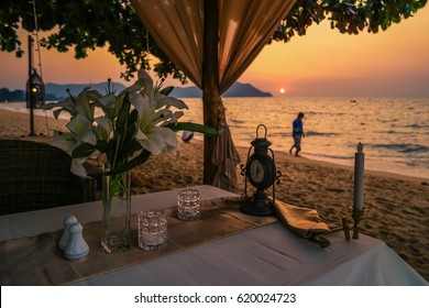 Dinner table on the beach during Sunset on the beach with a beautiful sky at Bangsaray Pattaya Thailand February 2017,dinner table romantic on the beach,
