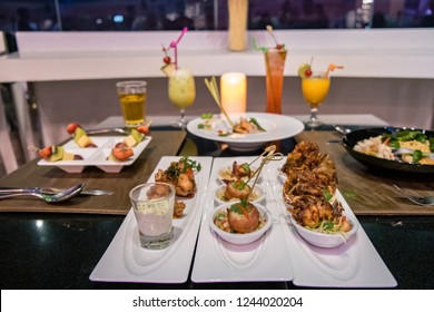 dinner table sky bar Thailand with luxury snacks and cocktails