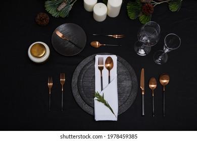 Dinner tableware set top view on black background