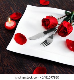 Dinner for two, roses, candles and forks
