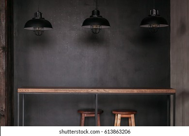 Dinning table set in loft style dining room with black lamps