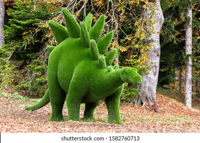 dinosaur created from bushes in green animals. Topiary Gardens. Topiary toy