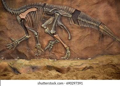 Dinosaur fossil simulator in sand background