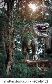 Dinosaur in the jungle with lens flare, Prachinburi thailand