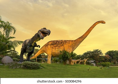 Dinosaur statue at Phu-Wiang forest dinosaur public park in Phu-Wiang on sunset sky background, Khonkaen of Thailand