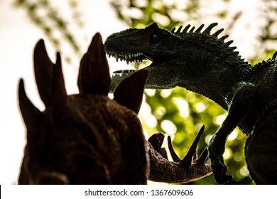 Dinosaurs fighting. Allosaurus fighting with stegosaurus.