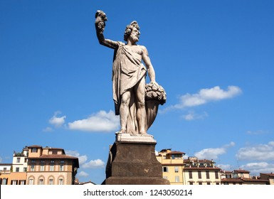 Dionysus sculpture standing on street of Florence. The god of the grape-harvest, winemaking and wine under the streets of historical Firenze, Italy.