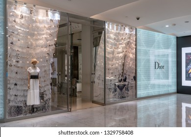Dior shop at Emquatier, Bangkok, Thailand, Feb 3, 2019 : Attractive front store of luxury clothing brand window display with white lace pattern decoration.