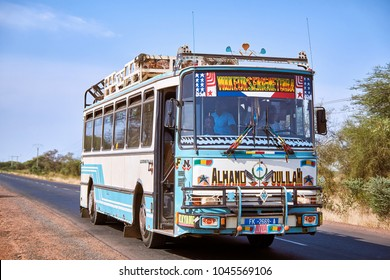 DIOURBEL/SENEGAL - NOVEMBER 15, 2013: Decorated african public shuttle bus on the road of Senegal
