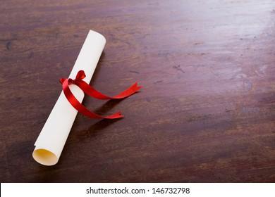 Diploma on wood table