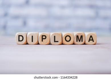 Diploma word written on wood block