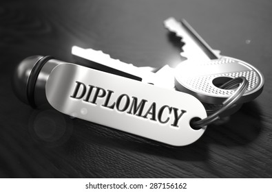Diplomacy Concept. Keys with Keyring on Black Wooden Table. Closeup View, Selective Focus, 3D Render. Black and White Image.