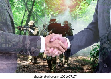 Diplomatic or business concept :   Leaders of the two countries Handshake to end the war Or the executives are negotiating the weapons trading.with background of military reconnaissance in the forest.