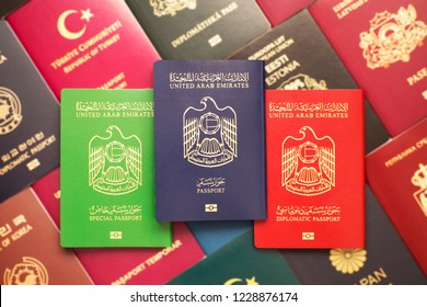 Diplomatic, official and civil passports of the United Arab Emirates against the background of various passports in many countries of the world