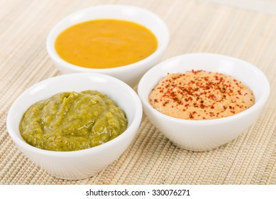 Dipping Sauces - Amarillo Chilli Sauce, Chimichurri and Roasted Pepper.
