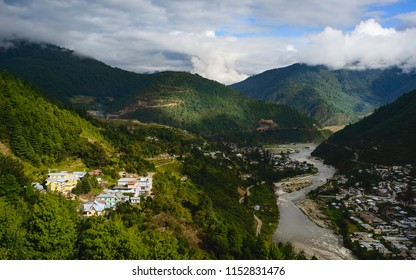Dirang, Arunachal Pradesh, India. Dirang town and Kameng river viewed across the Himalaya mountains at dawn in Dirang, Arunachal Pradesh, India.