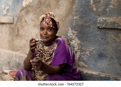 DIRE DAWA, ETHIOPIA-MARCH 28, 2017: Unidentified woman sips coffee at an outdoor cafe in Dire Dawa, Ethiopia.