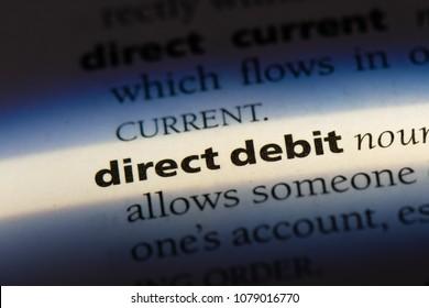 direct debit word in a dictionary. direct debit concept