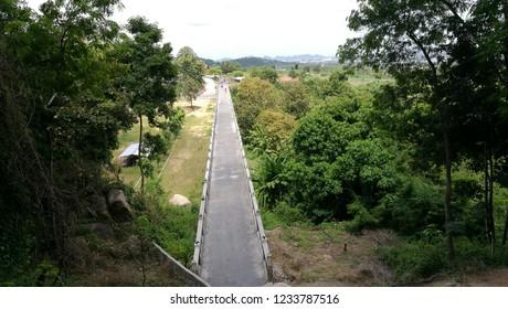 Direct mountain bridge. View to the horizon.
