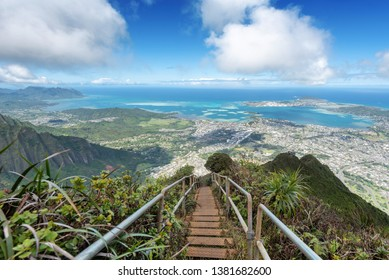 Direct shot at sun from a ridge trail on Oahu, Hawaii overlooking Kaneohe, Kailua and the windward side of the island on Haiku stairs