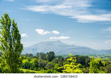Direct view on the Rhune mountain in Arcangues village with little clouds. Spring season. Basque Country of France