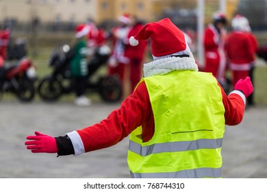 Directing traffic for Santa's on motorcycles.