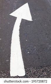 direction arrow on the road