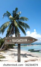 Direction holiday. Sign indicating the direction and in the background a tropical climate.
