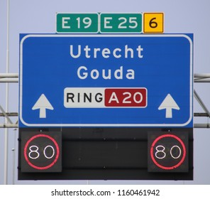 Direction and mandatory speed sign above motorway A20 heading to Gouda and Utrecht, also European way E19 and E25