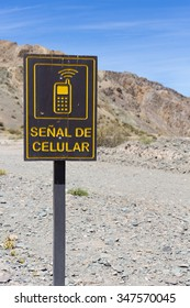 Direction road with sign cellular mobile phone signal road at El Alcazar pass on ruta 40 (Route 40), San Juan Province. Argentina