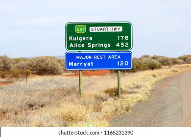 Direction road signs to Kulgera, Alice Springs, Marryat and rest area at Stuart Highway, Australian Outback