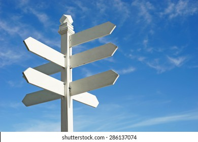 direction sign with blank spaces for text on beautiful sky background