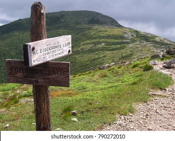 A direction sign marker pointing towards Mount Eisenhower.