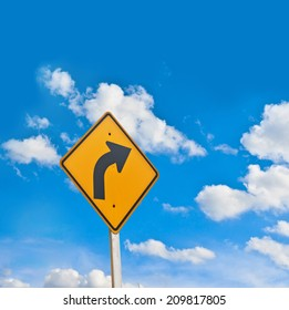 Direction sign- right turn warning on blue sky background