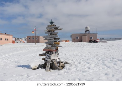 Direction signpost with distance to many different cities in Bellingshausen Russian Antarctic research station, King George island, Antarctica
