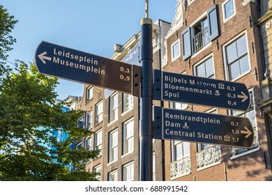Direction signs in Amsterdam - AMSTERDAM / THE NETHERLANDS - JULY 20, 2017
