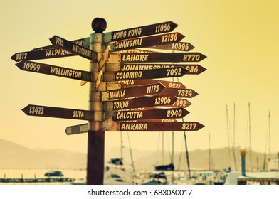 Direction signs with different destinations and distance, travel photo, retro style