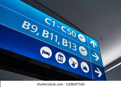 Direction signs inside a large airport