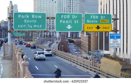 Direction signs in Manhattan on FDR Drive- MANHATTAN / NEW YORK - APRIL 1, 2017
