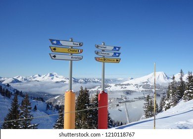 Direction signs on the snowy ski slopes in the Portes du Soleil ski area of the French Alps.