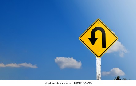 Directional arrow, U turn sign on pole isolated on bluesky background with clipping paths. - Shutterstock ID 1808424625